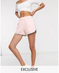 New Balance Pantaloncini rétro rosa pastello