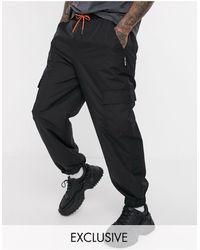 Collusion Pantalon cargo en nylon avec poches - Noir
