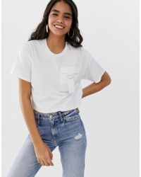 077333a469ce0 Lyst - ASOS T-shirt With Woven Cross Front in White
