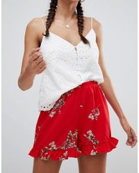 Missguided - Floral Frill Hem Shorts - Lyst