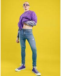 ASOS Jeans spray on power stretch lavaggio chiaro con abrasioni - Blu
