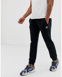 adidas Originals Joggers de corte slim negros con bordado de logo