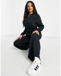 adidas Originals - Черный Комбинезон C Кружевами Bellista-черный Цвет - Lyst