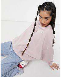 Nike – Kastenförmiges Oversize-Sweatshirt mit kleinem Swoosh-Logo - Pink