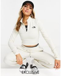 The North Face 1/4 Zip Fitted Cropped Long Sleeve Top - White