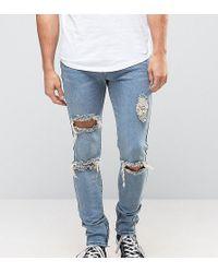 Liquor N Poker Skinny-Jeans mit Rissen und Reißverschluss am Knöchel - Blau