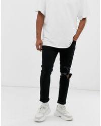 Mennace - Jeans skinny neri con strappi - Lyst