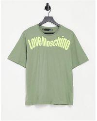 Love Moschino - Зеленая Футболка С Изогнутым Логотипом -зеленый Цвет - Lyst