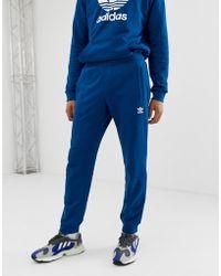 adidas Originals Blaue Jogginghose mit Dreiblatt-Logo