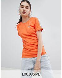 PUMA T-shirt avec bande sur le côté exclusivité ASOS - Orange