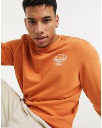 Herschel Supply Co. Sudadera con cuello redondo y estampado en el pecho - Naranja