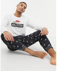 Hollister Set de regalo de ropa de estar por casa de joggers y camiseta de manga larga con logo navideño de - Multicolor