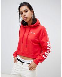 Calvin Klein Sudadera con capucha con logo extragrande en las mangas - Rojo