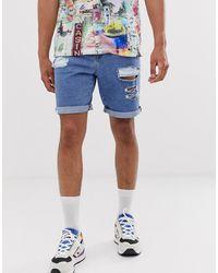ASOS Pantaloncini di jeans blu lavaggio scuro con strappi