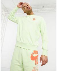 Nike Sudadera con cuello redondo y estampado gráfico world tour pack - Verde