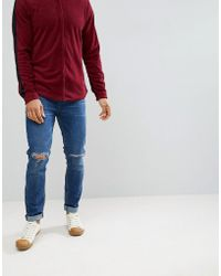 ASOS - Asos Skinny Jeans In Dark Wash With Knee Rips - Lyst