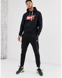 Nike Synthetik Schwarzer gewebter Trainingsanzug im Set