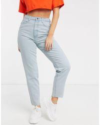Missguided - Mom jeans con fondo grezzo azzurri - Lyst
