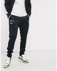 Nike Joggers en maille polyester avec logo virgule - Noir