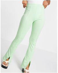 ASOS Pantalon skinny stretch taille haute avec ourlet fendu sur l'avant - pistache - Vert