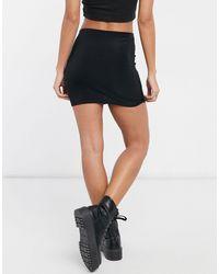 Collusion Mini-jupe taille basse à coupe près du corps style années 90 - Noir