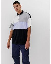 ASOS – Oversize-Polohemd aus Bio-Baumwolle - Schwarz