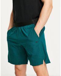 Reebok Pantaloncini verde scuro con vita a contrasto