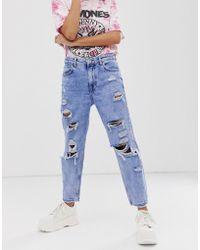 Bershka Blaue Mom-Jeans mit starken Rissen
