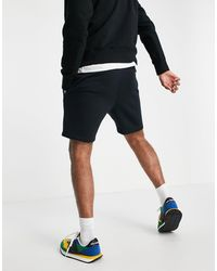 New Balance Exclusivité ASOS - Short en molleton à logo - Noir