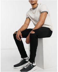 Only & Sons Jeans skinny neri con strappi alle ginocchia - Nero