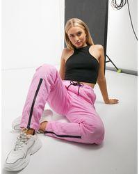 Ellesse Joggers con parte delantera con cremallera en rosa