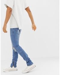Religion - Skinny Fit Jeans With Ripped Knee And Zip Hem - Lyst