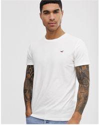 Hollister T-shirt girocollo bianca con logo - Bianco