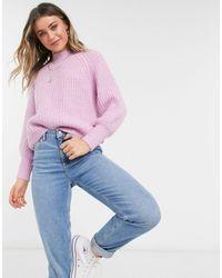 Pieces Jersey rosa pastel con cuello alto y mangas abullonadas