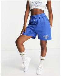 Missguided Shorts azules deportivos playboy sports