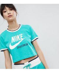 Nike - T-shirt verde con bordi a contrasto - Lyst