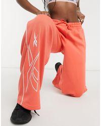 Reebok Training – Strick-Jogginghose mit weitem Bein - Orange