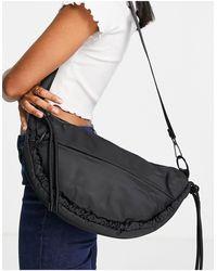 TOPSHOP Nylon Ruched Croissant Shape Crossbody Bag - Black