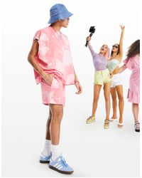 ASOS - Pantaloncini oversize lavaggio acido pesca - Lyst