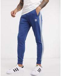 adidas Originals Joggers con logo a 3 strisce blu