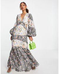 ASOS Vestito lungo con maniche lunghe, cut-out e dettaglio con bottoni, con stampa mista a fiori - Multicolore