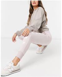 New Balance Joggers rosa con logo sovrapposto