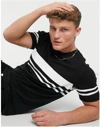 Burton – T-Shirt mit Streifen und Farbblock-Design - Schwarz