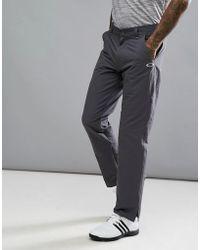 Oakley - Golf Take Trousers Regular Fit In Dark Grey - Lyst
