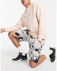 Mennace ‐ Jerseyshorts mit Batikmuster - Mehrfarbig