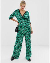 ba44863aecc Liquorish - Wrap Front Jumpsuit In Bright Leopard Print With Lace Trim  Sleeve Detail - Lyst