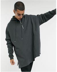 ASOS Sudadera muy extragrande con capucha y media cremallera en negro desgastado