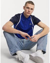 Lacoste Sport – Atmungsaktives Polohemd mit Ärmeln aus Netzstoff - Blau