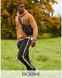 Polo Ralph Lauren Joggers negros con raya lateral dorada y logo