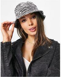 Pimkie Cappello da pescatore nero con stampa zebrata